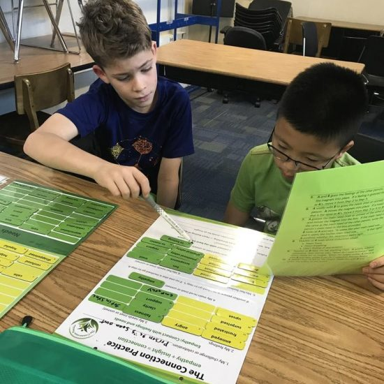Boys using the Connection Practice Boards